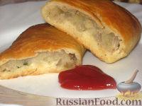 Фото к рецепту: Печеные пирожки с картошкой