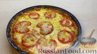 Фото к рецепту: Запеканка из кабачков с помидорами и сыром