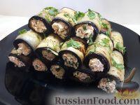 Фото к рецепту: Рулетики из баклажанов с творогом, сыром и орехами