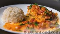 Фото к рецепту: Рыба с помидорами, в духовке