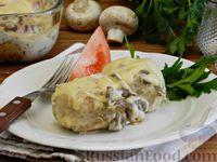 Фото к рецепту: Тефтели, запечённые под грибным соусом