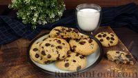 Фото к рецепту: Овсяное печенье с изюмом и шоколадом