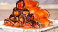 Фото к рецепту: Рулетики из баклажанов, маринованные в томатном соусе