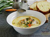 Фото к рецепту: Рыбный суп из консервированной горбуши, с сыром и шпинатом