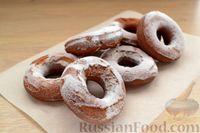 Фото к рецепту: Пышные пончики на сгущенке