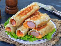 Фото к рецепту: Сосиски в лаваше с сыром (на сковороде)