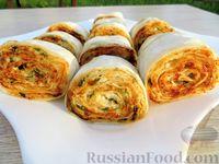 Фото к рецепту: Закуска из лаваша с курицей и плавленым сыром