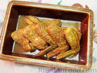 Фото к рецепту: Куриные крылышки с чесноком и карри, запечённые в пиве