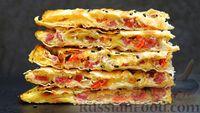Фото к рецепту: Лаваш с сыром, колбасой, помидорами и яйцами