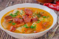 Фото к рецепту: Острый томатный суп с копчёными колбасками