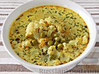 Фото к рецепту: Сырный суп с цветной капустой и горошком, на курином бульоне