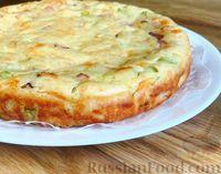 Фото к рецепту: Пирог с кабачками, ветчиной и сыром