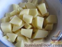 Фото приготовления рецепта: Суп с фрикадельками и рисом - шаг №6
