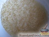 Фото приготовления рецепта: Суп с фрикадельками и рисом - шаг №7