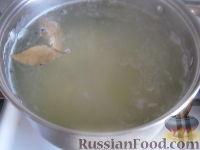 Фото приготовления рецепта: Суп с фрикадельками и рисом - шаг №8