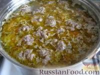 Фото приготовления рецепта: Суп с фрикадельками и рисом - шаг №12
