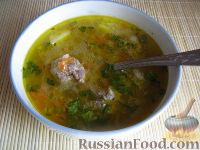 Фото приготовления рецепта: Суп с фрикадельками и рисом - шаг №13