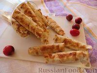 Фото к рецепту: Трубочки из лаваша с мясом, помидорами и сыром