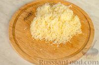 Фото приготовления рецепта: Новогодний салат с крабовыми палочками, ветчиной и сыром - шаг №10