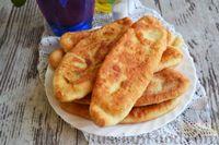 Фото к рецепту: Тонкие пирожки на кефире, с картошкой и плавленым сыром