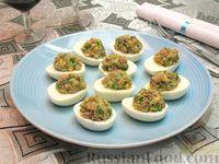 Фото к рецепту: Яйца, фаршированные сельдью