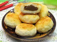 Фото к рецепту: Сырники с начинкой из варёной сгущёнки
