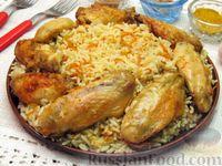 Фото к рецепту: Куриные крылышки, запечённые с рисом