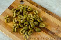 Фото приготовления рецепта: Мясные тефтели с сыром, в томатно-сметанном соусе с оливками - шаг №14