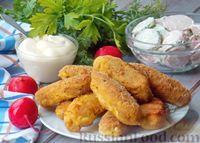 Фото к рецепту: Рыбные палочки с плавленым сыром, в панировке (во фритюре)