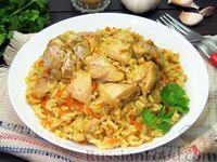 Фото к рецепту: Рис с курицей, морковью и луком (на сковороде)