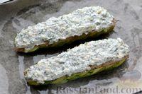 Фото приготовления рецепта: Минтай, запечённый с кабачками, под сырно-сметанным соусом - шаг №9