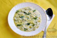 Фото приготовления рецепта: Куриный суп с макаронами, сметаной и яичными желтками - шаг №12