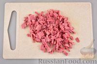 Фото приготовления рецепта: Песочные творожные рулетики-улитки с ветчиной и сыром - шаг №7