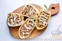 Фото приготовления рецепта: Перец, фаршированный кабачками, тушенный со сметаной и зеленью - шаг №10