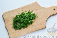 Фото приготовления рецепта: Перец, фаршированный кабачками, тушенный со сметаной и зеленью - шаг №11