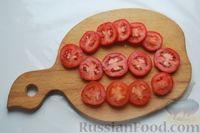 Фото приготовления рецепта: Кабачки с помидорами и фаршем, запеченные со сметаной и кетчупом - шаг №5
