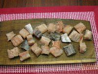 Фото приготовления рецепта: Рыба, тушенная с картошкой, баклажанами и кабачками - шаг №12