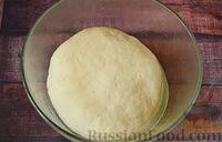 Фото приготовления рецепта: Чесночный хлеб «Улитка» - шаг №7