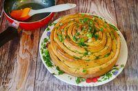 Фото приготовления рецепта: Чесночный хлеб «Улитка» - шаг №17