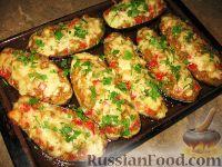 Фото приготовления рецепта: Баклажанные лодочки с овощами и фаршем - шаг №9