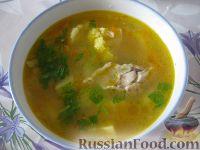 Фото к рецепту: Куриный суп с перловкой и цветной капустой