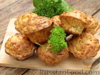 Фото к рецепту: Закусочные кабачково-сырные кексы