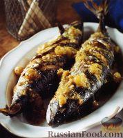 Фото к рецепту: Запеченная скумбрия под соусом из крыжовника
