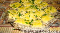 Фото к рецепту: Закусочный торт из лаваша