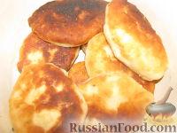Фото к рецепту: Дрожжевые жареные пирожки с картошкой