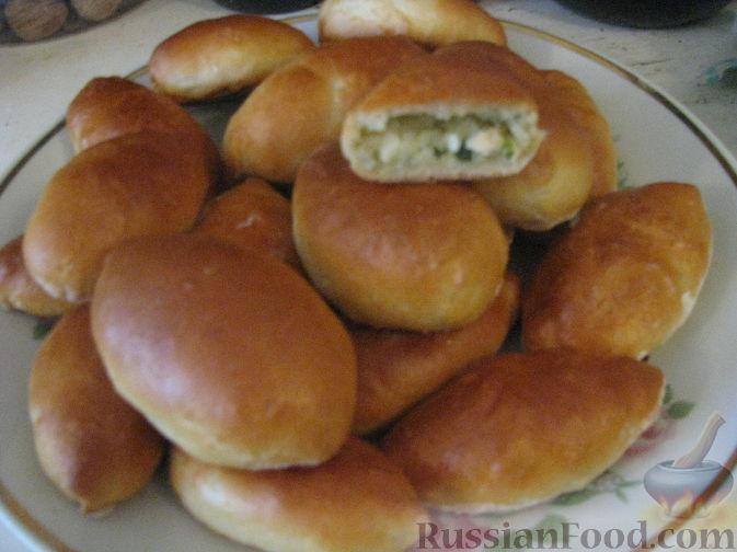 Пирожки с яйцом и рисом в духовке