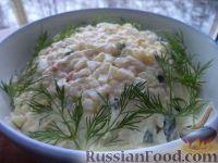 Фото к рецепту: Салат из кальмара с яйцами и рисом