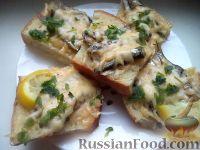 Фото к рецепту: Горячие бутерброды со шпротами или сардинами и сыром