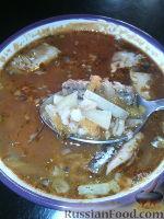 Фото к рецепту: Суп из рыбных консервов, с перловкой